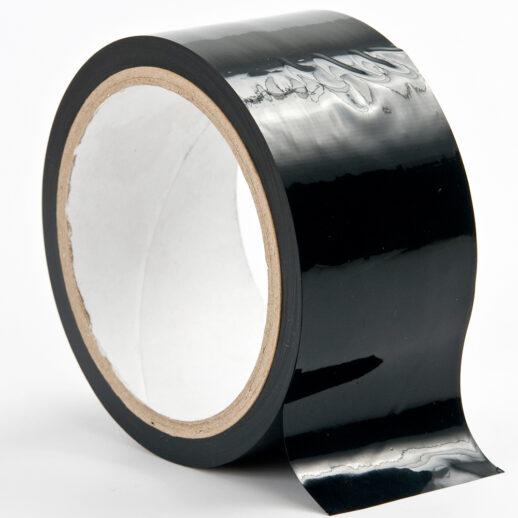 Bild på en svart tejprulle som är till för BDSM-lekar. Ouch Bondage Tape.